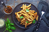 Rigatoni with pesto rosso and basil