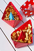 Red paper boats filled with snacks