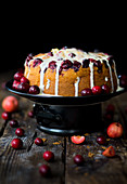 Apple pie with cranberries and icing