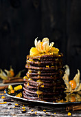 Chocolate pancakes with oranges and physalis