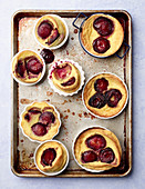 Plum Clafoutis out of the oven on baking sheet