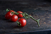 Vine tomatoes on a black metal tray