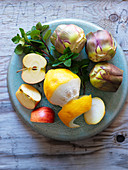 Ingredients for smoothies with artichokes, lemon, apple and mint