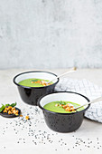 Pea soup with nut topping, sesame and yoghurt