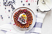 Pumpkin waffles with blueberries and yoghurt