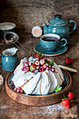 Pavlova with fresh and frozen berries