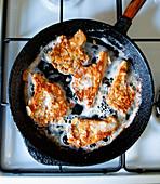 Oyster mushroom schnitzel in a pan