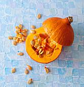 Hokkaido pumpkin, halved, with seeds