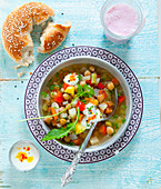 Chickpea soup with sesame bread and chili ayran yoghurt