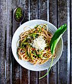 Spaghetti with wild garlic pesto, parmesan and roasted pine nuts