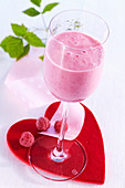Raspberry milkshake made with fresh raspberries and honey