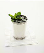 Mint julip in silver cup garnished with mint leaves
