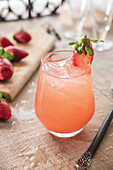 Strawberry sake sangria with whole strawberry garnish