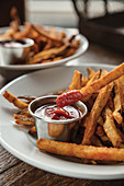 Fries dipped in homemade ketchup