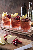 Three apple cranberry mule cocktails
