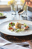 Fig foie gras withpecan salad and maple vinaigrette