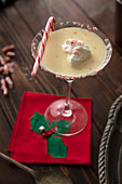 Eggnog martini with candy cane garnish