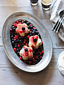 Semolina pudding with redcurrants and blueberries