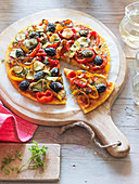 Polenta pizza with onions, peppers and olives