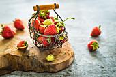 Fresh summer strawberries in a metal basket