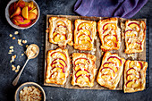 Puff pastry tarts with marzipan and peaches