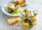 Pickled creamy Camembert with olives, onion and sage served with grilled baguette