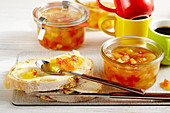 Pineapple and papaya jam with banana in jars and on buttered bread