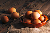 Chicken eggs on napkin on wooden table