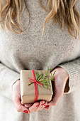 Woman holding small Christmas present