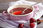 Homemade jam with fresh sweet cherries