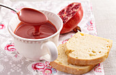 A cup of pomegranate curd with a spoon