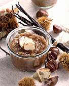 A jar of chestnut preserve with vanilla and chestnuts