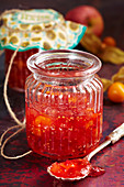 Homemade apple and physalis jam in a vintage jar