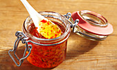Chilli and apple jelly in a flip-top jar