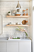 Open shelving in kitchen with white subway tiles