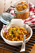 Spicy pumpkin relish in a dish and in jars