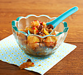 Apple and onion chutney in a small glass bowl