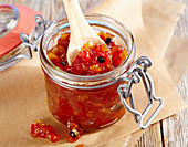 Spicy pepper relish in a flip-top jar
