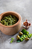 Celery pesto with green olives and anchovies