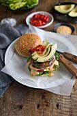 A hamburger with avocado and chilli
