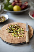 Chopped pistachio nuts on a wooden board
