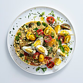 Couscous bake with cherry tomatoes and egg