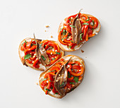 Pepper crostini with anchovies