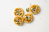 Puff pastry mini pizzas with pepper and mozzarella