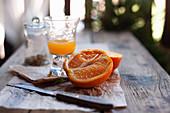Sliced orange and orange juice on a wooden table