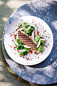 Grilled sea bass with spinach and mushrooms