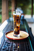 Cold brew in a glass on a table outside