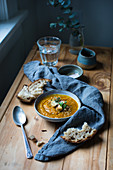 Carrot soup with roasted cauliflower served with bread