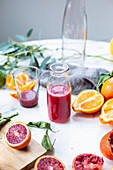 Freshly pressed blood orange juice in a glass and in a bottle