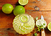 Homemade lime and lemonade with mint and mineral water